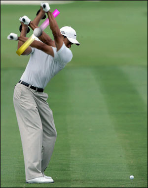 tiger woods top of the swing