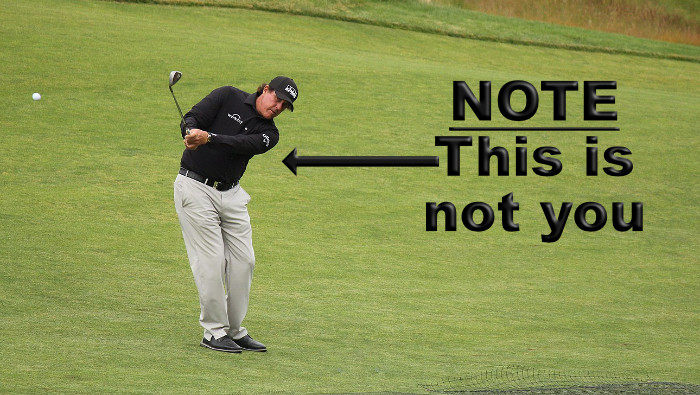 Phil Mickelson hitting golf chip shot