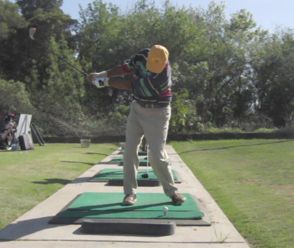 golfer with a short backswing